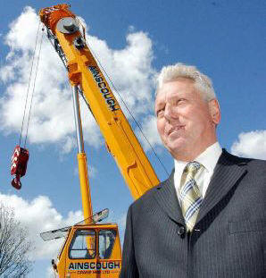 Martin Ainscough infront of crane